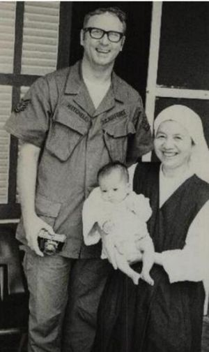 James Mitchell with Sister Angela Nguyen and the baby, Tran Thi Ngoc Bich (Precious Pearl). Mitchell adopted the infant ...