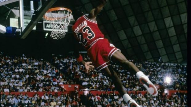 Jordan makes a spectacular dunk in the late eighties for the Chicago Bulls.