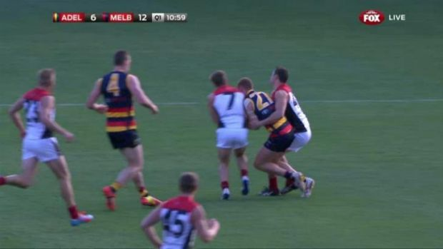 Adelaide's Tom Lynch was forced from the ground due to injury, later revealed to be a broken jaw, because of a collision ...