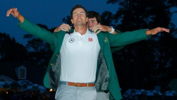 'I want to stamp my foot down as a big-time player': Bubba Watson gives Scott the green jacket at the 2013 Masters.