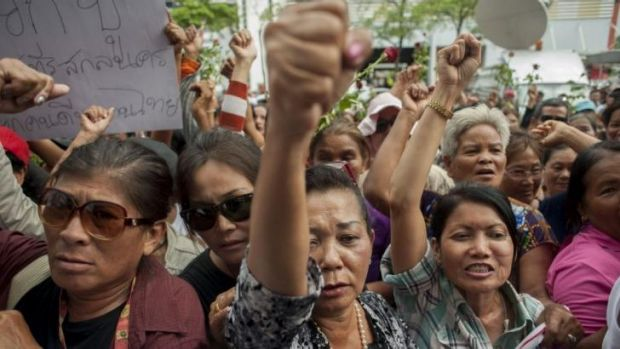 Supporters of former Thai prime minister, Yingluck Shinawatra, react to her removal from power.