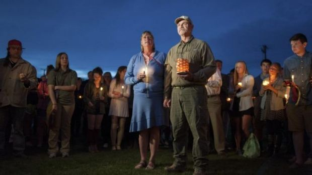 'This is not us': Kate Walker and Randy Smith, the host family of slain exchange student Diren Dede, attend a vigil for ...