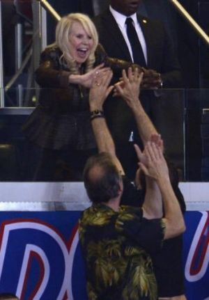 Shelly Sterling, wife of Donald Sterling, high fives fans in the final seconds of the Clippers defeat of the Golden ...
