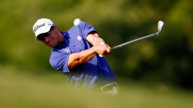 "Adam Scott hits a shot on the 14th hole during the first round of The Players Championship. ""I didn't tee off today ..."