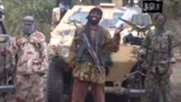 Fanatic: Boko Haram leader Abubakar Shekau (centre) delivers a speech in the video released on Monday.