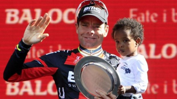 Making history: Cadel Evans celebrates a place on the podium in 2013 with his son Robel.