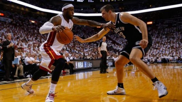 LeBron James of the Miami Heat drives against Mirza Teletovic of the Brooklyn Nets during game two of the Eastern ...