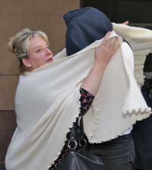 Accused: Lukas Kamay and his mother outside the court.
