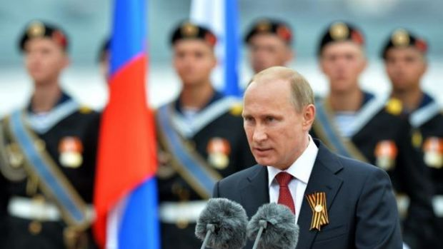 Patriotic speech ... Russian President Vladimir Putin speaks during his visit to the Crimean port of Sevastopol. ...
