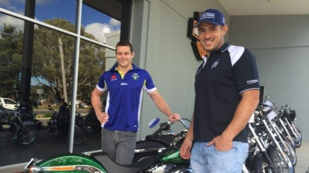 Canberra Raiders stars Shaun Fensom and Terry Campese with the bike raffled off to raise money for the Terry Campese ...