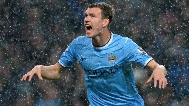Reigning: Manchester City's Edin Dzeko will be hoping he has a title to celebrate this weekend.