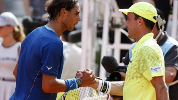 Rafael Nadal shakes hands with compatriot Roberto Bautista Agut after the semi-final.