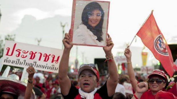 High stakes: pro-government red shirts rally in support of ousted prime minister Yingluck Shinawatra on the outskirts of ...