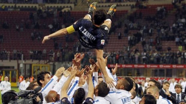 Javier Zanetti's teammates celebrated with him after the match.