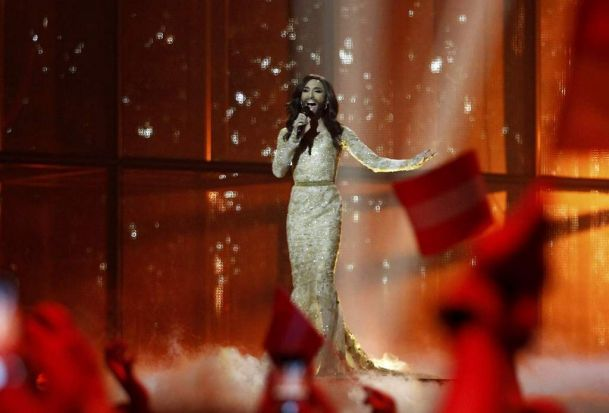 "Conchita Wurst representing Austria performs the song ""Rise Like a Phoenix"" during the grand final of the 59th ..."