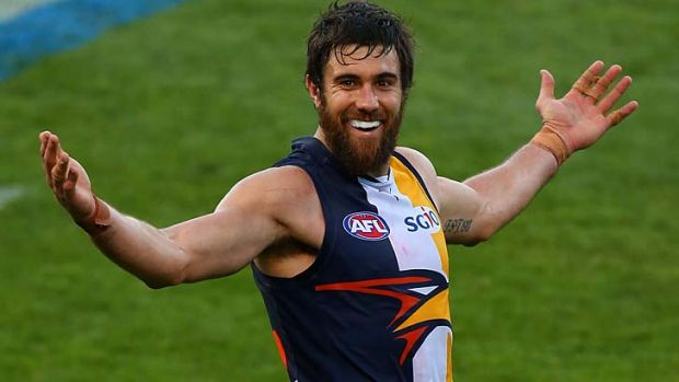 Ten and counting: West Coast's Josh Kennedy has good reason to smile after kicking his 10th goal against the Giants on ...