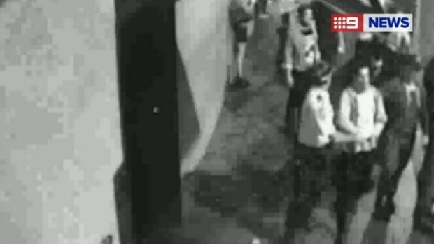 Mitchell Pearce led away by police.