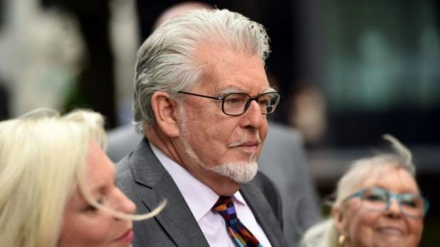 Rolf Harris arrives at court on Friday with his wife Alwen Hughes and daughter Bindi.