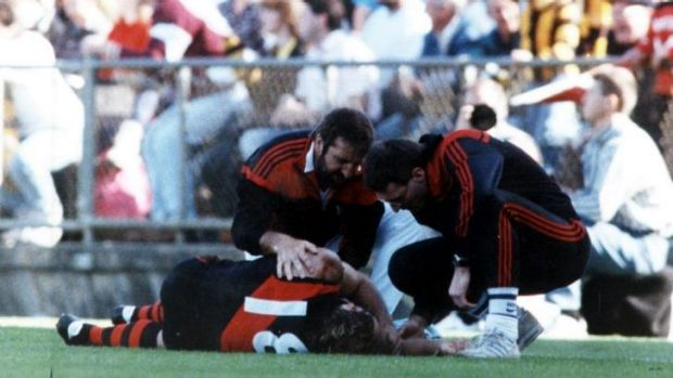 Paul Vander Haar on the ground after his collision with Hawthorn's Dermott Brereton in 1989.