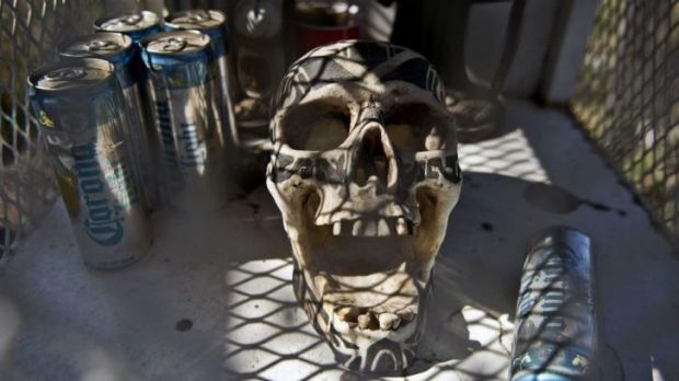 A skull is seen at the entrance of the town of Arteaga, in Michoacan State, Mexico, where Servando Gomez is known to ...