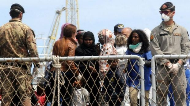 Earlier operation ... Migrants wait to disembark an Italian Navy ship in the port of Palermo, Sicily on May 2 after ...