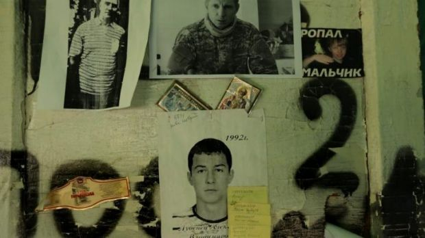 The faces of either dead or missing people are pinned to a wall at a checkpoint on the outskirts of Slaviansk.
