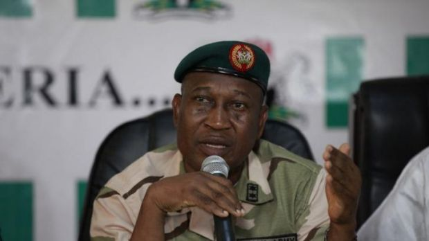 Search: Brigadier General Chris Olukolade, Nigeria's top military spokesman, speaks during a news conference on the ...