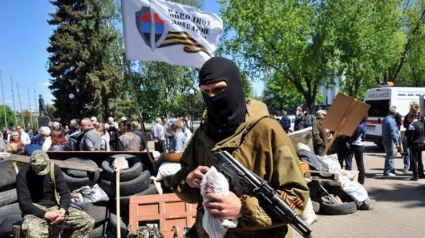 Armed pro-Russian militiants guard a barricade outside the regional state building in Kramatorsk, eastern Ukraine, near ...
