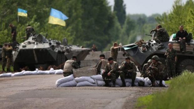 Ukranian military soldiers man a highway checkpoint near Slovyansk. At least 6 Ukranian soldiers were killed and more ...