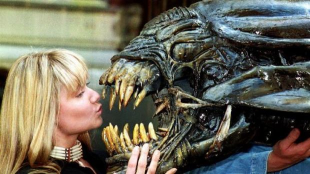 Sculptress Emma Pryke with Swiss surrealist designer Hans Ruedi Giger's monster used in the film <i>Aliens</i>.