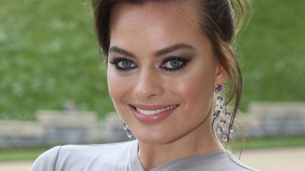 Margot Robbie arrives at the dinner to celebrate the work of The Royal Marsden hosted by Prince William.