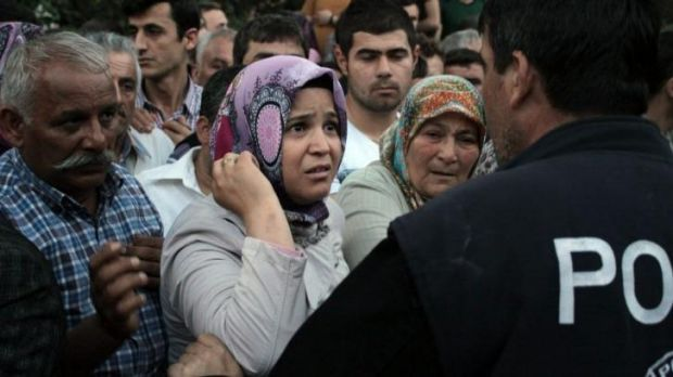 Relatives try to get information outside a local hospital after the blast.