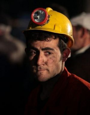 A miner awaits the rescue of trapped friends outside the coal mine in Soma, Turkey.