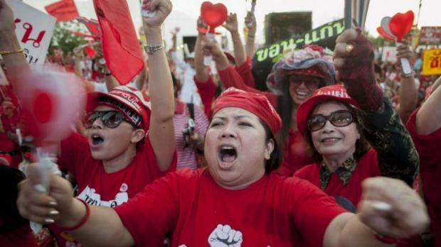 Pro-government red shirt supporters react during a speech in Bangkok.