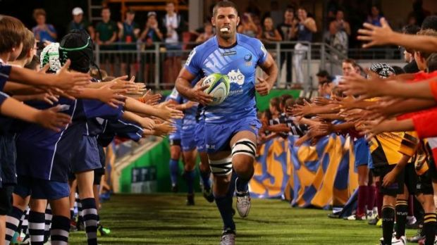 Wallaby chance: Matt Hodgson of the Force leads his team on to the field before the match against  the Brumbies.