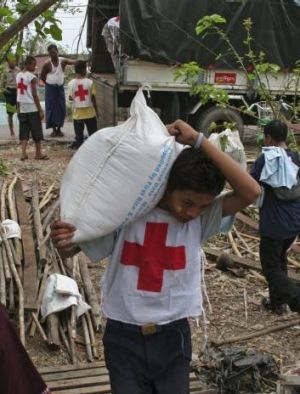 Myanmar Red Cross workers unload emergency food donations.