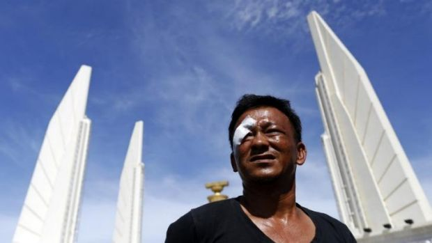 Boonying Manjit, who said he was wounded in a gun and grenade attack on Thursday at the Democracy Monument in Bangkok. ...