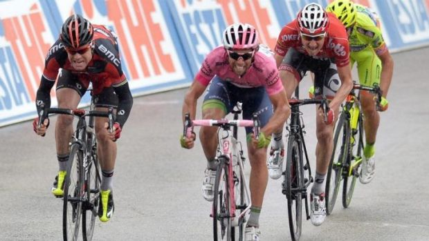Michael Matthews, second left, approaches the finish line to win the sixth stage of the Giro d'Italia, from Sassano to ...