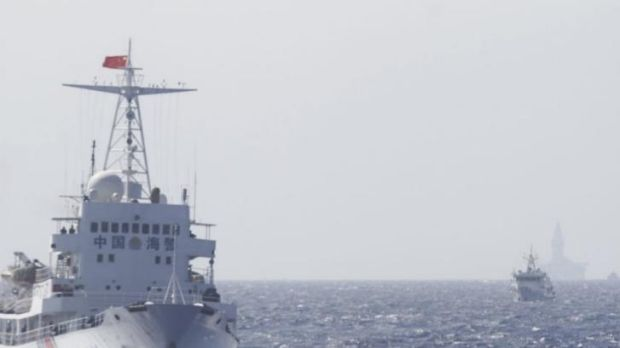 Chinese coast guard ships are seen near China's Haiyang Shiyou 981 oil rig in the South China Sea, about 210 km off ...