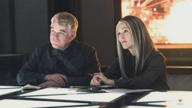 Philip Seymour Hoffman and Julianne Moore in <i>The Hunger Games: Mockingjay - Part 1</i>.