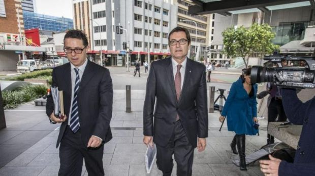 Former climate change minister Greg Combet arrives at the inquiry in Brisbane.