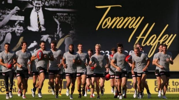 Players train in front of a billboard honouring the late Tom Hafey at punt Road.