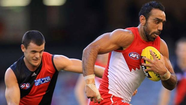 Veteran Adam Goodes attempts to run off Bomber Brent Stanton.