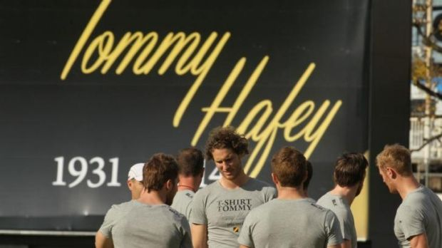 Richmond players at training at Punt Road on Friday, with a tribute to Hafey in the background.