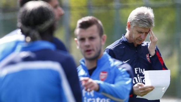 Headache: Arsene Wenger at training as Arsenal prepared for the FA Cup.