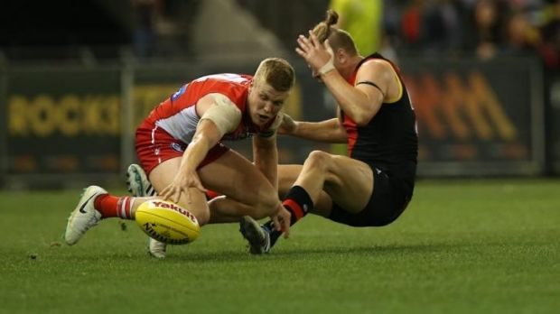 Sydney's Dan Hannebery (right) cannons into Bomber Michael Hurley in the last quarter.