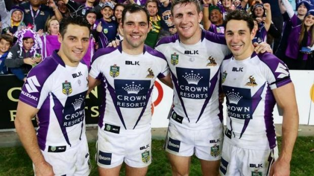 Cooper Cronk, Cameron Smith, Ryan Hoffman and Billy Slater of the Storm celebrate a combined total of 1000 games on ...