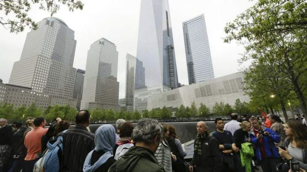 Expressions of loss: Visitors at the September 11 Memorial, which opened this week.