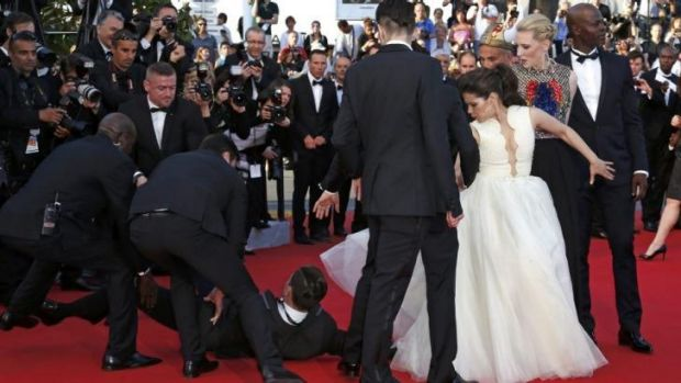 Cate Blanchett looks on as the man is dragged away.