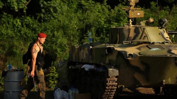 Standoff: A checkpoint manned by an assortment of Ukrainian military personnel outside the town of Slavyansk in eastern ...